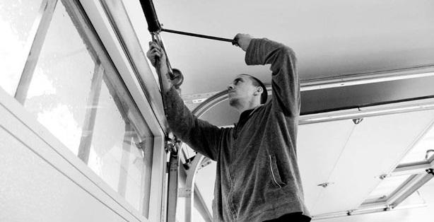 Broken Garage Door Repair For Roller Replacement by Specialists